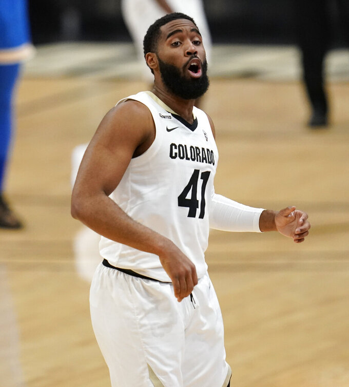 Colorado forward Jeriah Horne reacts after hittitng a shot during the second half of the team's NCAA college basketball game against UCLA on Saturday, Feb. 27, 2021, in Boulder, Colo. (AP Photo/David Zalubowski)