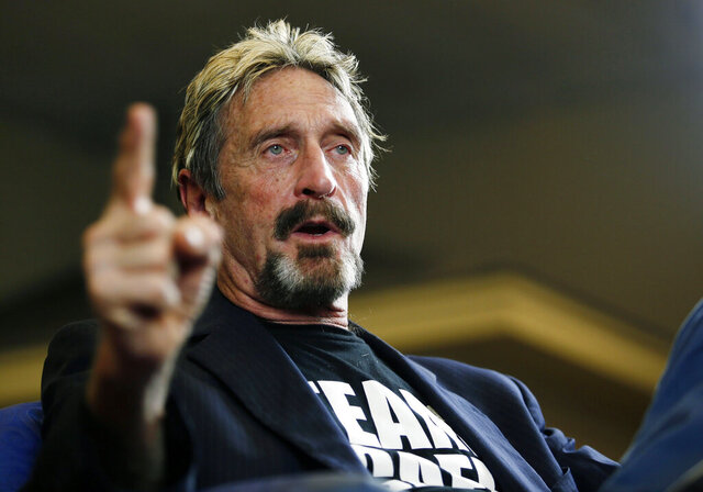 FILE - In this Sept. 9, 2015, file photo, internet security pioneer John McAfee announces his candidacy for president in Opelika, Ala. McAfee has been charged with evading taxes after failing to report income made from promoting cryptocurrencies while also doing consulting work, making speaking engagements and selling the rights to his life story for a documentary, prosecutors in Tennessee said Monday, Oct. 5, 2020. (Todd J. Van Emst/Opelika-Auburn News via AP, File)