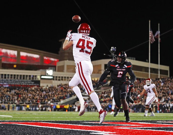 FILE - In this Saturday, Nov. 3, 2018, file photo, Oklahoma's Carson Meier (45) catches the ball for a touchdown during the first half of an NCAA college football game against Texas Tech in Lubbock, Texas. Oklahoma quarterback Kyler Murray  has star receivers in Marquise Brown and CeeDee Lamb, yet he doesn't hesitate to throw to other options such as Meier. (AP Photo/Brad Tollefson, File)