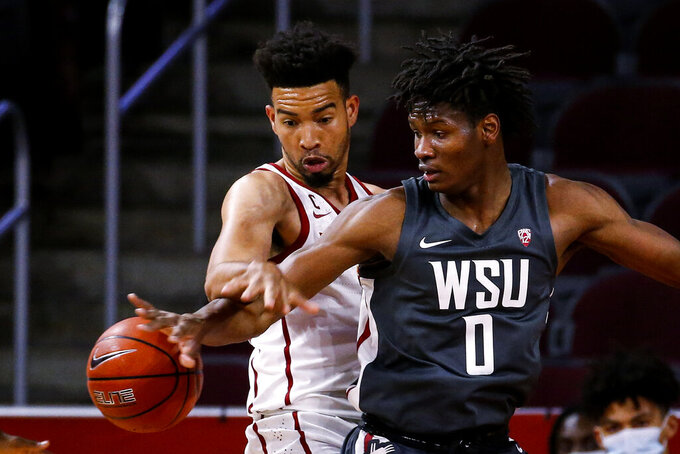 Washington State center Efe Abogidi (0) Southern California forward Isaiah Mobley reach for the ball during the first half of an NCAA college basketball game Saturday, Jan. 16, 2021, in Los Angeles. (AP Photo/Ringo H.W. Chiu)