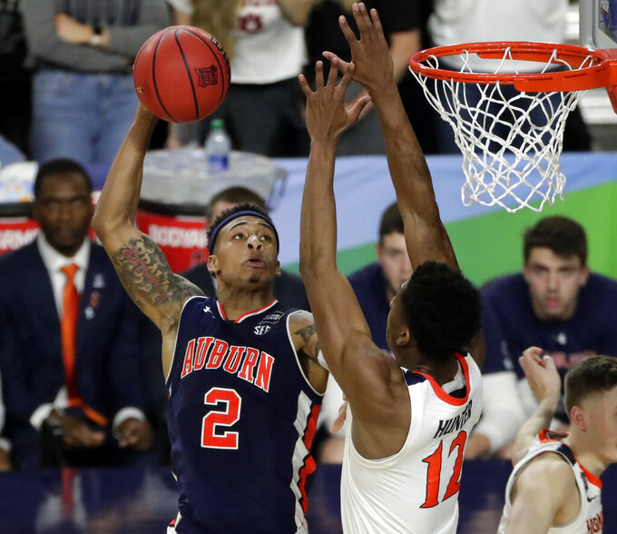 Auburn guard Bryce Brown (2) shoots over Virginia guard De'Andre Hunter (12) during the second half in the semifinals of the Final Four NCAA college basketball tournament, Saturday, April 6, 2019, in Minneapolis. (AP Photo/Matt York)