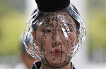 A model displays a creation featuring the Korean alphabet, Hangeul, by one of 40 designers during the Hangeul fashion show as a part of Seoul 365 Fashion Show at the National Hangeul Museum in Seoul, South Korea, Monday, Sept. 9, 2019. (AP Photo/Lee Jin-man)