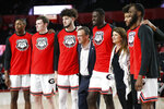 Georgia coach Tom Crean center poses for photos with his senior players on senior night, before the team's NCAA college basketball game against Missouri ion Wednesday, March 6, 2019, in Athens, Ga. (Joshua L. Jones/Athens Banner-Herald via AP)
