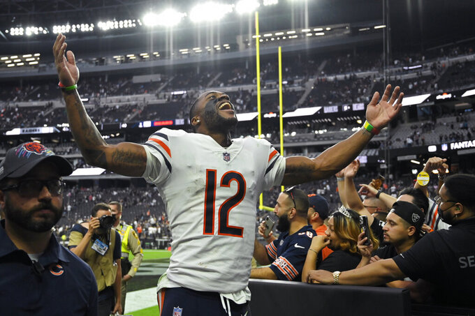 Chicago Bears wide receiver Allen Robinson (12) celebrates as he runs off the field after the Chicago Bears defeated the Las Vegas Raiders in an NFL football game, Sunday, Oct. 10, 2021, in Las Vegas. (AP Photo/David Becker)