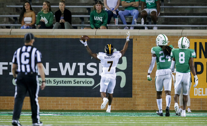 Southern Mississippi running back Darius Maberry (7) celebrates after scoring a touchdown during the second half of an NCAA college football game against North Texas on Saturday, Oct. 3, 2020, in Denton, Texas. (AP Photo/Brandon Wade)