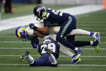 Los Angeles Rams wide receiver Josh Reynolds (11) is tackled by Seattle Seahawks free safety D.J. Reed (29) and linebacker K.J. Wright (50) during the first half of an NFL football game, Sunday, Dec. 27, 2020, in Seattle. (AP Photo/Elaine Thompson)