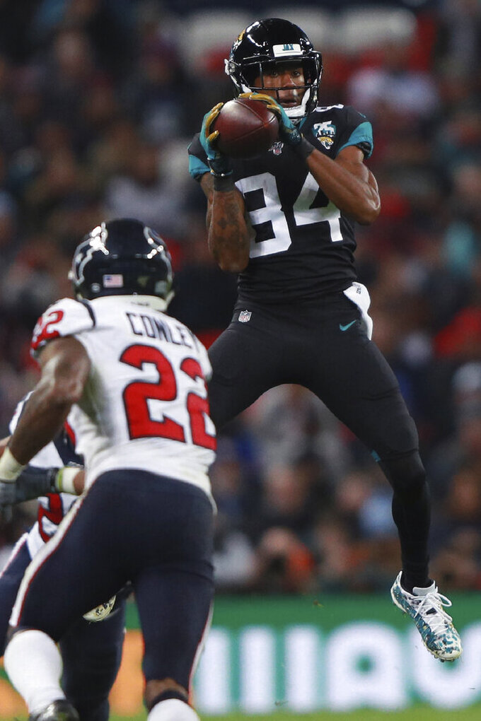 Jacksonville Jaguars wide receiver Keelan Cole (84) makes the catch against the Houston Texans during the second half of an NFL football game at Wembley Stadium, Sunday, Nov. 3, 2019, in London. (AP Photo/Ian Walton)