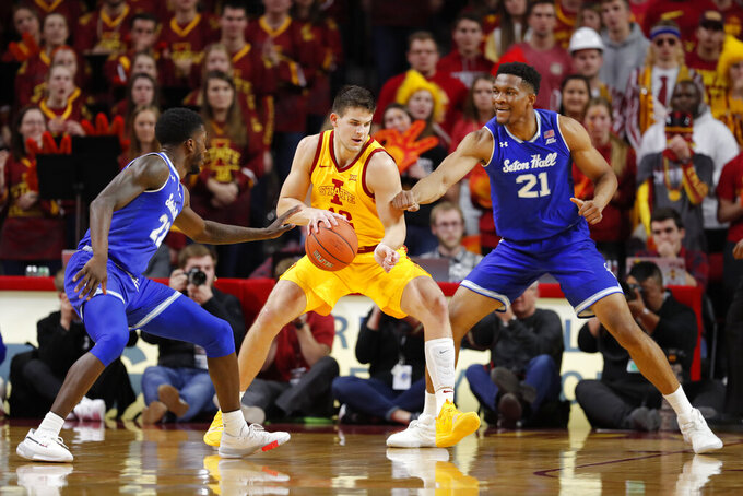 Iowa State forward Michael Jacobson, center, battles Seton Hall guard Myles Cale, left, and Seton Hall center Ike Obiagu, right, to get to the basket during the first half of an NCAA college basketball game, Sunday, Dec. 8, 2019, in Ames, Iowa. (AP Photo/Matthew Putney)