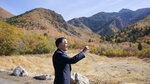 Sen. Mitt Romney, R-Utah, looks on following a news conference Thursday, Oct. 15, 2020, near Neffs Canyon, in Salt Lake City. Romney announced legislation to establish a national wildfire commission that would make policy recommendations aimed at diminishing future wildfire disasters. (AP Photo/Rick Bowmer)