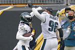 Philadelphia Eagles running back Miles Sanders (26) celebrates his touchdown with Derek Barnett (96) during the first half of an NFL football game against the Pittsburgh Steelers, Sunday, Oct. 11, 2020, in Pittsburgh. (AP Photo/Keith Srakocic)