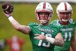 FILE - North Carolina State quarterback Devin Leary (13) passes during an NCAA college football practice in Raleigh, N.C., in this Wednesday, Aug. 4, 2021, file photo. Eighteen starters are back from the Wolfpack's eight-win team in 2020. (AP Photo/Gerry Broome, File)