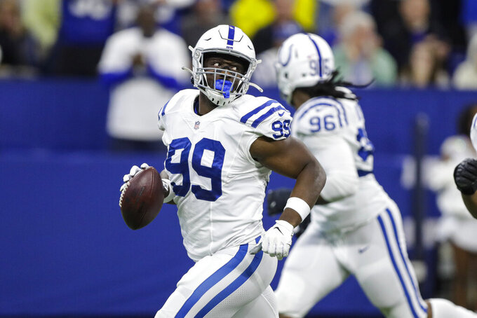 Indianapolis Colts defensive end Justin Houston (99) celebrates after recovering a Tennessee Titans fumble during the first half of an NFL football game in Indianapolis, Sunday, Dec. 1, 2019. (AP Photo/Darron Cummings)