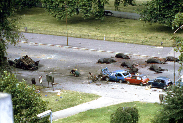 "FILE - In this July 20, 1982 file photo, horses from a detachment of the Queen's Household Cavalry and two soldiers became victims of a nail bomb in Hyde Park, London. A British judge on Wednesday Dec. 18, 2019, found that a 67-year-old Irishman was an ""active participant"