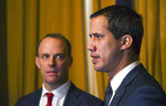 Venezuela's Opposition leader Juan Guaido, right, during a meeting with British Foreign Secretary Dominic Raab at Foreign Office in London, Tuesday, Jan. 21, 2020. (AP Photo/Alberto Pezzali)