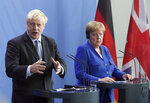 German Chancellor Angela Merkel and Britain's Prime Minister Boris Johnson address the media during a joint press conference as part of a meeting at the Chancellery in Berlin, Germany, Wednesday, Aug. 21, 2019. (AP Photo/Michael Sohn)