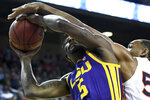 Auburn center Austin Wiley (50) blocks a shot by LSU forward Emmitt Williams (5) during the first half of an NCAA college basketball game Saturday, Feb. 8, 2020, in Auburn, Ala. (AP Photo/Julie Bennett)