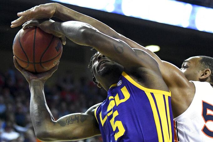 Auburn center Austin Wiley (50) blocks a shot by LSU forward Emmitt Williams (5) during the first half of an NCAA college basketball game Saturday, Feb. 8, 2020, in Auburn, Ala. (AP Photo/Julie Bennett)