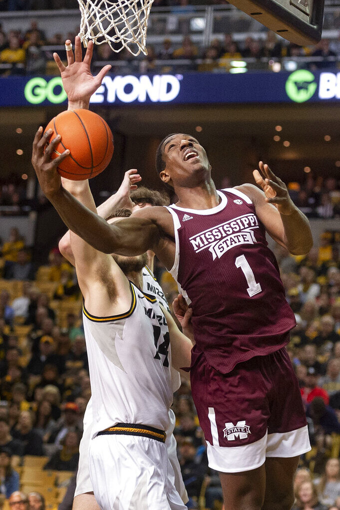 Mississippi State's Reggie Perry, right, shoots past Missouri's Reed Nikko, left, during the first half of an NCAA college basketball game Saturday, Feb. 29, 2020, in Columbia, Mo. (AP Photo/L.G. Patterson)