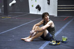 In this June 18, 2019, photo, professional rock climber Alex Honnold sits on the padded floor at the Earth Treks gym in Englewood, Colo. Honnold is trying to get a grip on life in the aftermath of the Academy Award winning documentary