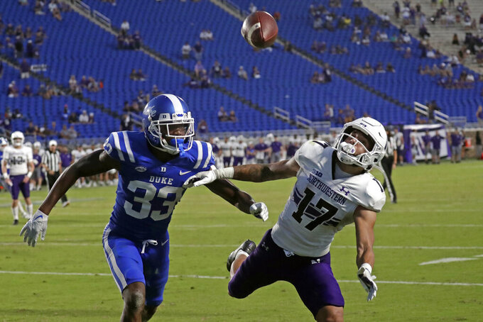 Duke cornerback Leonard Johnson (33) breaks up a pass intended for Northwestern wide receiver Bryce Kirtz (17) during the second half of an NCAA college football game against in Durham, N.C., Saturday, Sept. 18, 2021. (AP Photo/Chris Seward)