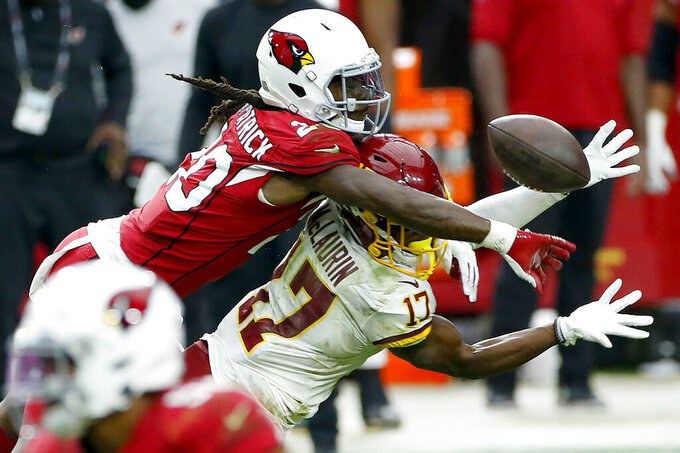 Arizona Cardinals cornerback Patrick Peterson (21) breaks up a pass intended for Washington Football Team wide receiver Terry McLaurin (17) during the second half of an NFL football game, Sunday, Sept. 20, 2020, in Glendale, Ariz. (AP Photo/Darryl Webb)