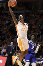 Tennessee's Jordan Bowden drives for a layup past UNC Asheville's LJ Thorpe during an NCAA college basketball game Tuesday, Nov. 5, 2019, in Knoxville, Tenn. (Tom Sherlin/The Daily Times via AP)