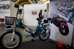 A Mishozuki SS-3.0 electric bicycle is on display on the opening day of the annual International Trade Fair in Havana, Cuba, Monday, Nov. 4, 2019. (AP Photo/Ismael Francisco)