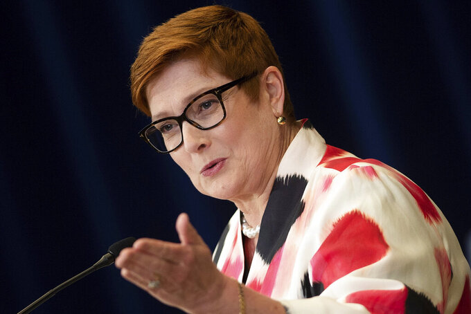 """FILE - In this  July 28, 2020, file photo, Australia's Foreign Minister Marise Payne speaks at a news conference at the State Department, in Washington. Australia has suspended its defense cooperation with Myanmar and is redirecting humanitarian aid because of the military takeover of the government and ongoing detention of an Australian citizen. Payne said on Monday, March 8, 2021 that Australian diplomats only had access to economic policy adviser Sean Turnell twice since he was detained in early February. She described the access as """"very limited consular support."""" (Brendan Smialowski/Pool Photo via AP, File)"""
