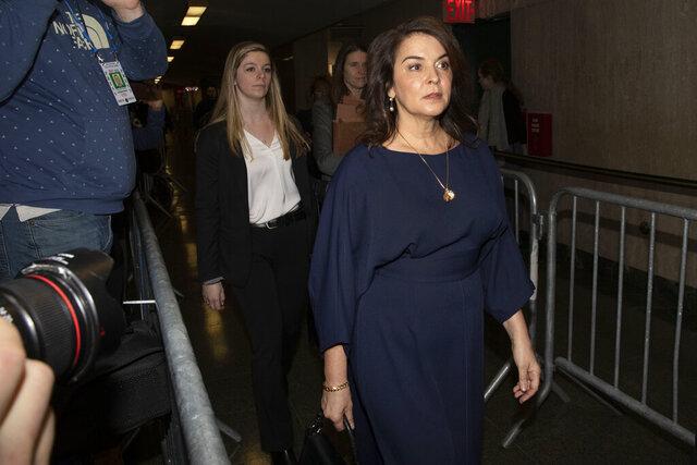 Actress Annabella Sciorra, right, arrives as a witness in Harvey Weinstein's rape trial, in New York, Thursday, Jan. 23, 2020. (AP Photo/Richard Drew)