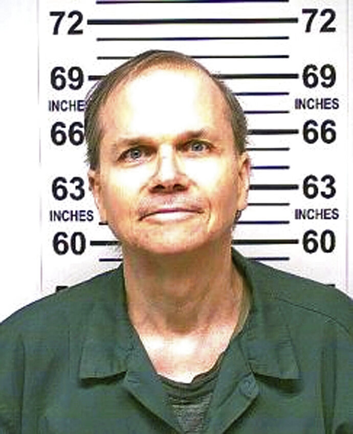 """FILE -  This Jan. 31, 2018 photo, provided by the New York State Department of Corrections, shows Mark David Chapman, the man who killed John Lennon outside his Manhattan apartment in 1980. Chapman said he was seeking glory and deserved the death penalty for the """"despicable"""" act. Chapman made the comments in response to questions last month from a parole board, which denied him parole for an 11th time. (New York State Department of Corrections via AP, File)"""