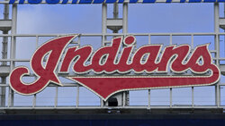 """The Indians sign hangs at Progressive Field before the first baseball game of a doubleheader against the Chicago White Sox, Thursday, Sept. 23, 2021, in Cleveland. On Sunday, one of the American League's charter members will play its final home game of 2021, and also its last at Progressive Field as the Indians, the team's name since 1915, when """"Shoeless"""" Joe Jackson was the starting right fielder on opening day. Much more than a late-season matchup against the Chicago White Sox, the home finale will signify the end of one era and beginning of a new chapter for the team, which will be called the Cleveland Guardians next season. (AP Photo/Tony Dejak)"""