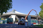 Workers and a cement pumping truck are shown, Tuesday, Sept. 1, 2020, as work continues on the Climate Pledge Arena in Seattle, the home of the Seattle Kraken NHL hockey team. Sometime in the late summer or early fall of 2021, the Kraken will open the new facility -- at a cost that will likely total $1 billion by the time it's done -- and become the NHL's 32nd franchise. (AP Photo/Ted S. Warren)