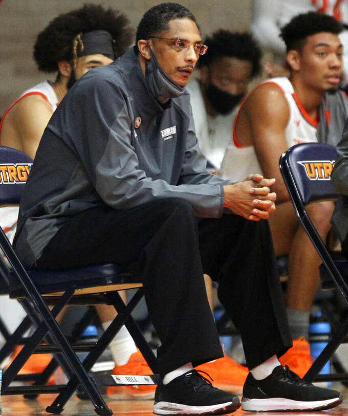 Texas Rio Grande Valley coach Lew Hill is seen during an NCAA college basketball game against Dixie State at the UTRGV field house in Edinburg, Texas, Saturday, Jan. 16, 2021. Texas Rio Grande Valley says Hill died Sunday, Feb. 7, 2021, a day after coaching a basketball game against Texas Southern. He was 55. (Delcia Lopez/The Monitor via AP)