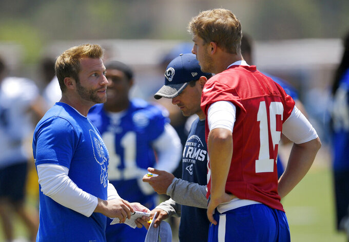 FILE - In this June 5, 2017, file photo, Los Angeles Rams coach Sean McVay, left, talks with quarterback Jared Goff, right, as offensive coordinator Matt LaFleur stands between them during NFL football practice in Thousand Oaks, Calif. Green Bay Packers coach LaFleur and Rams coach McVay say their friendship and shared history shouldn't have much of an impact on their teams' upcoming NFC divisional playoff matchup. (AP Photo/Mark J. Terrill, File)
