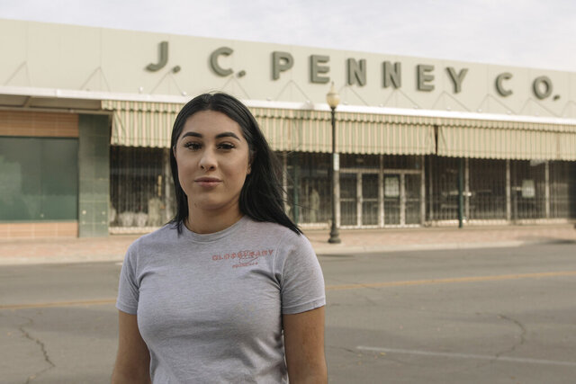 Alexandra Orozco stands for a portrait outside of the closed J.C. Penney where she was laid off from, in Delano, Calif., on Sunday, Dec. 6, 2020. Orozco began working part-time at the department store when she was 18, and in nearly four years rose through the ranks from cashier to freight team associate. (Madeline Tolle/The Fuller Project via AP)