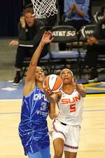 Connecticut Sun's Jasmine Thomas (5) scores on a reverse layup past Chicago Sky's Candace Parker during the first quarter of a WNBA basketball game Thursday, June 17, 2021, in Chicago. (AP Photo/Charles Rex Arbogast)