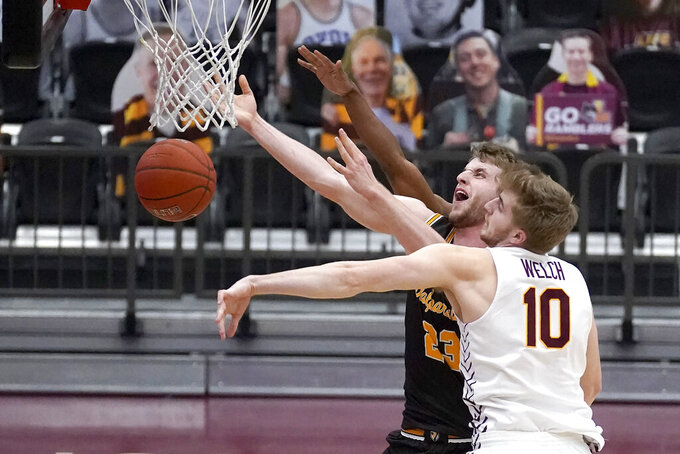 Loyola Chicago's Tom Welch (10) blocks the shot of Valparaiso's Ben Krikke during the first half of an NCAA college basketball game Wednesday, Feb. 17, 2021, in Chicago. (AP Photo/Charles Rex Arbogast)