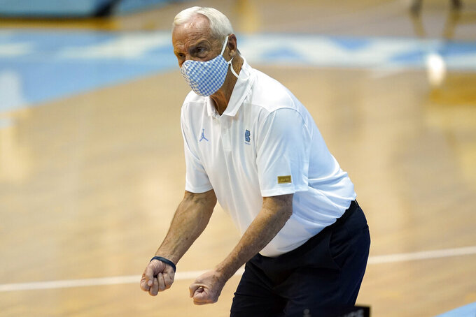 North Carolina coach Roy Williams directs his players during the second half of an NCAA basketball game against College of Charleston in Chapel Hill, N.C., Wednesday, Nov. 25, 2020. (AP Photo/Gerry Broome)