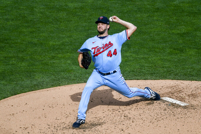 """FILE - Minnesota Twins pitcher Rich Hill throws against the Cincinnati Reds during the first inning of a baseball game in Minneapolis, in this Sunday, Sept. 27, 2020, file photo. Rich Hill is frank when he talks about why he's excited to join the Tampa Bay Rays. """"The opportunity to win — and win now,"""" the 40-year-old left-hander, who's chasing a World Series championship that's eluded him during a major league career that spans portions of 16 seasons with nine other teams, said.(AP Photo/Craig Lassig, File)"""