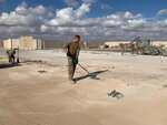 U.S. Soldiers clean up with brooms while bulldozers clear rubble and debris at Ain al-Asad air base in Anbar, Iraq, Monday, Jan. 13, 2020. Ain al-Asad air base was struck by a barrage of Iranian missiles on Wednesday, in retaliation for the U.S. drone strike that killed atop Iranian commander, Gen. Qassem Soleimani, whose killing raised fears of a wider war in the Middle East. (AP Photo/Ali Abdul Hassan)