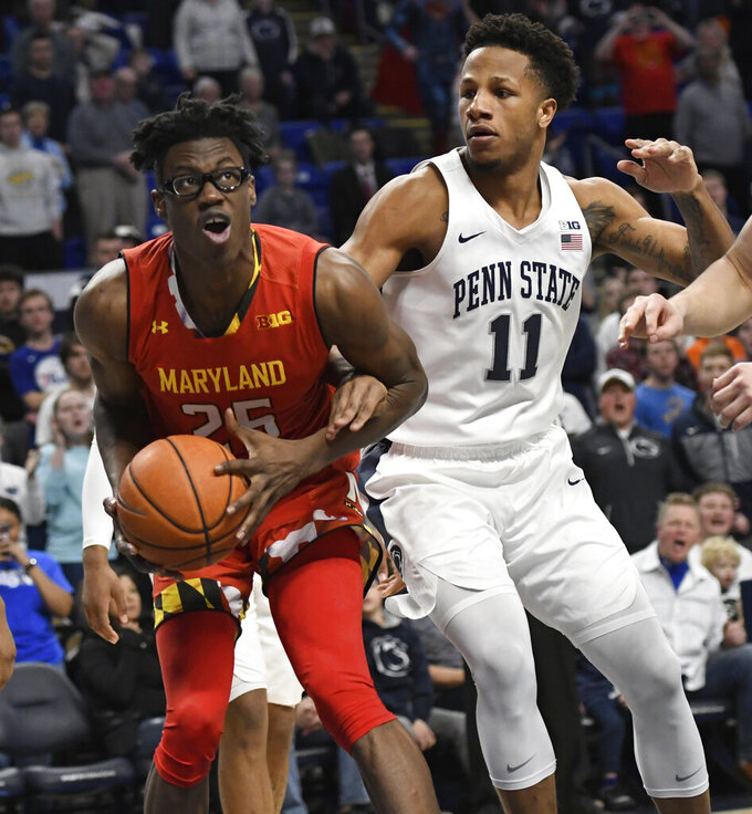 Maryland forward Jalen Smith (25) is defended by Penn State forward Lamar Stevens (11) during the first half of an NCAA college basketball game Wednesday, Feb. 27, 2019, in State College, Pa. (AP Photo/John Beale)
