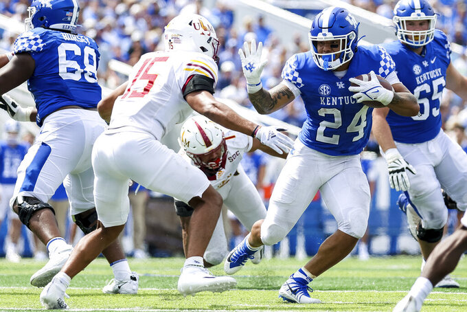 Kentucky running back Chris Rodriguez Jr. (24) stiff arms Louisiana-Monroe safety Austin Hawley (15) during the second half of an NCAA college football game against Louisiana-Monroe in Lexington, Ky., Saturday, Sept. 4, 2021. (AP Photo/Michael Clubb)