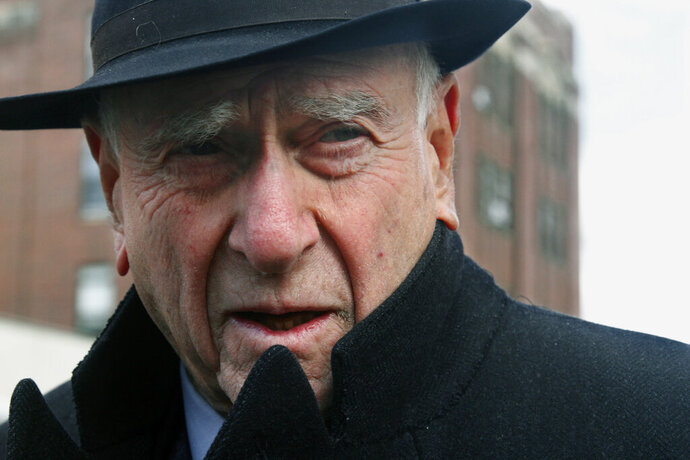 FILE - In this March 4, 2011 file photo, federal Judge Jack Weinstein speaks with reporters after visiting the Louis Armstrong housing projects in Bedford-Stuyvesant section of Brooklyn, New York. Weinstein, who was nominated by President Lyndon Johnson and who contributed to the landmark case that struck down racial segregation in public schools is retiring at age 98. (AP Photo/Bebeto Matthews, File)