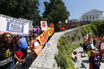 Protesters line the septs of the Capitol as the special session on gun issues was about to begin at the State Capitol in Richmond, Va., Tuesday, July 9, 2019. Governor Northam called a special session of the General Assembly to consider gun legislation in light of the Virginia Beach Shootings both chambers voted to adjourn until Nov. 18. (AP Photo/Steve Helber)