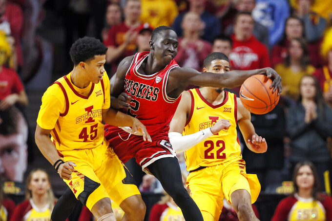 Northern Illinois guard Gairges Daow, center, fights for a loose ball with Iowa State's Rasir Bolton, left, and Tyrese Haliburton, right, during the second half of an NCAA college basketball game, Tuesday, Nov. 12, 2019, in Ames, Iowa. Iowa State won 70-52. (AP Photo/Charlie Neibergall)