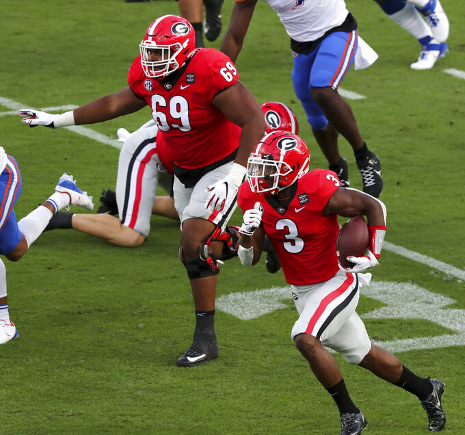Georgia running back Zamir White (3) runs to score a touchdown on the opening play against Florida  during the first half of a NCAA college football, Saturday, Nov. 7, 2020, in Jacksonville, Fla. (Curtis Compton/Atlanta Journal-Constitution via AP)