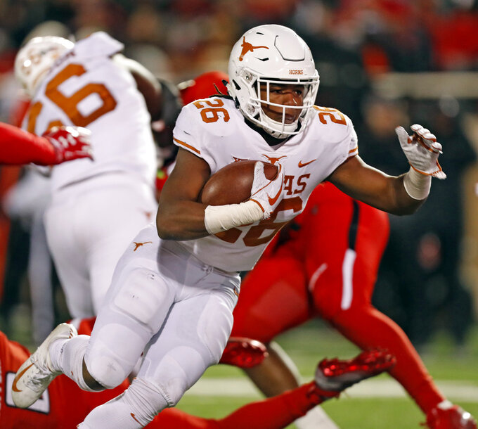 Texas' Keaontay Ingram (26) runs the ball into the end zone for a touchdown during the first half of an NCAA college football game against Texas Tech, Saturday, Nov. 10, 2018, in Lubbock, Texas. (AP Photo/Brad Tollefson)