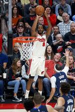 Portland Trail Blazers forward Trevor Ariza (8) shoots over Dallas Mavericks guard Seth Curry during the second half of an NBA basketball game in Portland, Ore., Thursday, Jan. 23, 2020. (AP Photo/Craig Mitchelldyer)
