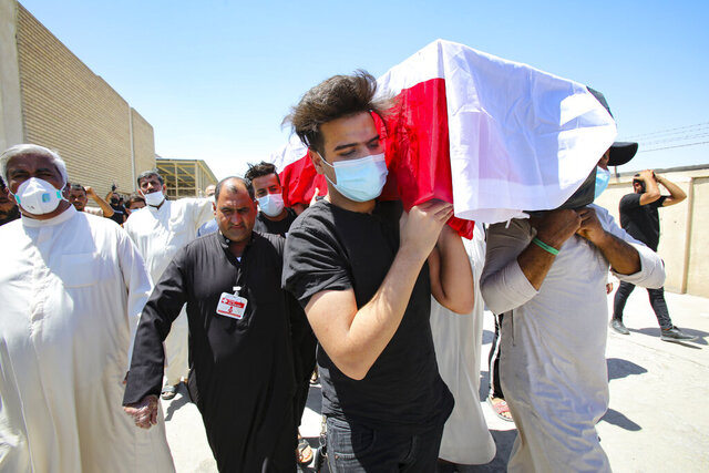 Mourners escort the flag-draped coffin of activist Reham Yacoub during her funeral procession in Basra, Iraq, Thursday, Aug. 20, 2020. Activist Reham Yacoub was gunned down in the southern Iraqi province of Basra on Wednesday by unidentified gunmen, a security official and human rights watcher said, marking the second such killing in the span of a week. The official spoke on condition of anonymity in line with regulations. (AP Photo/Nabil al-Jurani)