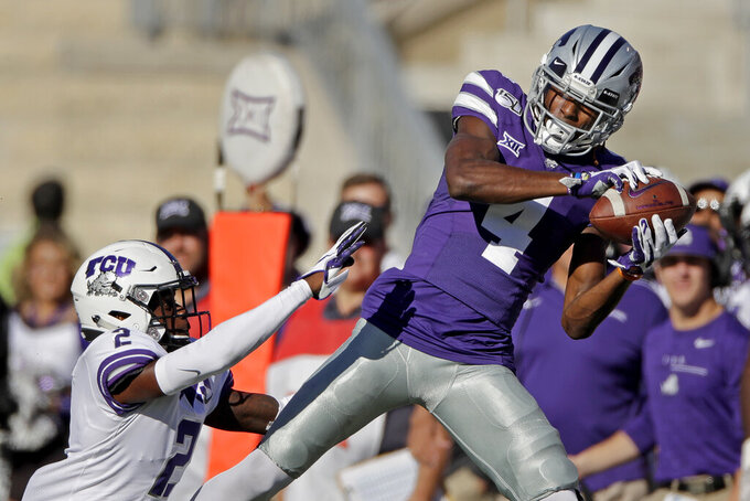 Kansas State wide receiver Malik Knowles (4) catches a pass under pressure from TCU cornerback Kee'yon Stewart (2) during the second half of an NCAA college football game Saturday, Oct. 19, 2019, in Manhattan, Kan. Kansas State won 24-17. (AP Photo/Charlie Riedel)
